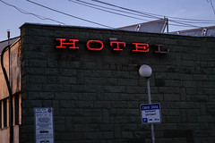 HOTEL (dragonllabroe) Tags: hotel sign neon light wall building bulgaria architecture urban sunset dark outside outdoor street parking lot signs