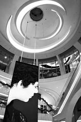 (perryge) Tags: hongkong urban city architecture escalator geometry ad blackandwhite indoors interior mall moko mongkok kowloon people