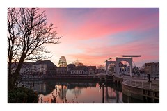 Out of the gates (Photodoos) Tags: zierikzee sunrise red clouds zeeland netherlands town drawbridge