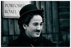 The fake smile of CHARLIE CHAPLIN. (Serapic) Tags: people bw london smile hat random fake moustache charlie whisker londra champlin