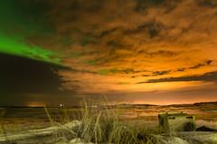 Aurora Borealis (Claire Willans) Tags: winter light sky color colour green landscape solar iceland skies glow vibrant aurora keflavik icy northernlights auroraborealis brunnastaÿir