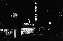 Cost Mart (aaronvandorn) Tags: winter blackandwhite jerseycity highcontrast streetscene kodaktrix pushed minoltasrt201 journalsquare rokkor 6400iso bergenavenue newkirkstreet