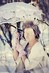 A Bitter Patience (MounaTahar) Tags: trees winter woman white snow cold tree ice nature girl beautiful fashion forest umbrella hair photography photo eyes dress emotion princess wind photos lace magic fineart dream makeup surreal kingdom queen redhead sparkle story fantasy bow editorial crown mystical accessories brunette gaze maiden throne bitter mouna snowqueen tahar storiesofelsewhere mounatahar