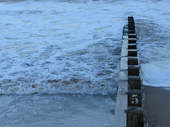The fifth wave (shaggy359) Tags: wood sea beach water seaside sand waves post 5 five tide wave line number foam dorset barrier posts groyne swanage spume seabreak {vision}:{outdoor}=099 {vision}:{sky}=0801