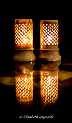 Day 311, 2016, a photo a day. (lizzieisdizzy) Tags: light candle burn holder chinese china oriental soapstone flame bright heat table glass reflec reflection shiny circular plinth bottom case tube darkbackground reflect shining burning