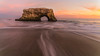 Afterburner (Darkness of Light) Tags: pacific ocean santa cruz davenport natural bridges state beach wave sunset highway 1 rock formation arch water streaks neutral density filter hoya 3stop alpenglow