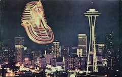 A Golden Image Of King Tut Looms Over Seattle, Washington, 1978 (SwellMap) Tags: postcard vintage retro pc chrome 50s 60s sixties fifties roadside midcentury populuxe atomicage nostalgia americana advertising coldwar suburbia consumer babyboomer kitsch spaceage design style googie architecture neon night evening dark street marquee
