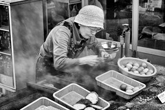 Japan - Beppu - Onsen Eggs (st3000) Tags: asia japan kyushu travel fuji xpro1 xf1855 beppu steam onsen blackandwhite bw egg eggs onsenegg woman elderly hat eating food foodie cooking chef
