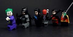A Family Chase (MrKjito) Tags: lego minifig batman joker robin nightwing redhood son bat damian wayne bruce dick grayson jason todd tim drake family photo