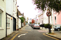 A street in Notting Hill (Katrinitsa) Tags: london2016 london uk greatbritain england europe nottinghill neighbourhood street streetphotography cars houses buildings architecture city cityscape cityview corner sign colors white morning canon canoneosrebelt3i ef35mmf14lusm pink streetview citycenter arrow parking walking autumn outdoors