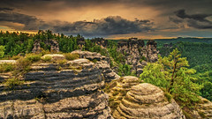 saxony swiss in germany (bocero1977) Tags: stone landscape nature mountains mood outdoor weather clouds trees rocks elbsandsteingebirge sky saxonyswissmountains light bizzar bastei colors green view germany wide valley