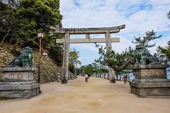 Itsukushima XVIII (Douguerreotype) Tags: japan hiroshima miyajima buddhist shrine temple torii gate statue people