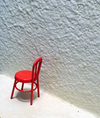 Exile (Enchanticals) Tags: red white metal wall one miniature chair solitude alone little empty small bistro gone retro uno lonely solitary vignette une oldfashioned redchair penance metalchair onechair redmetal flickrunited enchanticals minitreasures enchanticalsetsy