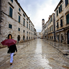 Dawn commute in Dubrovnik (Hip Hippy) Tags: street old city morning travel light sky cloud house building tower heritage church monument beautiful rain stone architecture umbrella sunrise square religious dawn town europe mediterranean catholic view cathedral outdoor pavement background famous faith religion croatia places landmark tourist medieval historic unesco clear holy sacred paving destination christianity dubrovnik sights adriatic dalmatia