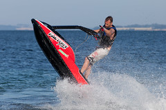 Jetski by Niv beach (mistermacrophotos) Tags: blue red summer water tattoo canon fun denmark jump play zoom spray mk2 5d motor mm jetski skidoo 70300
