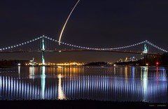 Like A Rocket Ship Into Outer Space (Clayton Perry Photoworks) Tags: winter canada skyline night vancouver reflections lights bc northshore rocket lionsgatebridge northvancouver yvr tyeechoice
