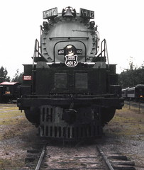 Steamtown, USA display of former Union Pacific Railroad ALCO built Big Boy # 4012, a 4-8+8-4 articulated steam locomotive, seen in a front view at the museum in Riverside, Vermont, August 1982 (alcomike43) Tags: old color classic museum vintage photo display engine slide trains historic steam photograph unionpacific locomotive freighttrains bigboy articulated steamengine railroads steamlocomotive alco 4012 4884 bellowsfallsvermont steamtownusa riversidevermont