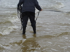 Wet fun (willi2qwert) Tags: black beach wet water girl strand women wasser boots wave wellies watt rubberboots gummistiefel wellingtons gumboots soaked raingear flooded nass rainboots rainpants regenstiefel