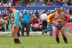2012 Naadam introduction ceremony - two wrestlers (10b travelling / Carsten ten Brink) Tags: 2012 asia carstentenbrink iptcbasic naadam ulaanbaatar festival two national sports ceremony opening introductory parade wrestling wrestler mongolia mongolei peopleset 1000plus