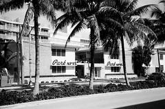 Midcentury Apartment Building (Phillip Pessar) Tags: camera bw white film analog 35mm store zoom kodak infinity tx trix olympus x thrift 400 tri 70 blck