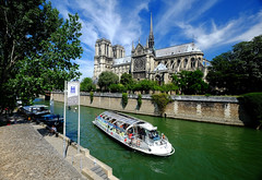 On the River Seine in Paris (` Toshio ') Tags: toshio paris france boat seine river riverseine notredame notredamecathedral clouds water trees europe european europeanunion fujixe2 xe2
