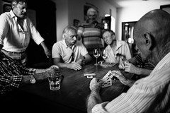 Playing hard in osteria (Giulio Magnifico) Tags: bar blackwhite friuliveneziagiulia udine wine cards game players friends vintage old reportage 28mm madeinitaly frasca osteria italy friuli leicaq leica