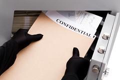 Stealing confidential documents (pcwalton1) Tags: burglar burglary criminal gloves open safe safety safetydepositbox security securitysystem stealing thief valuable vaulteddoor hand data confidential document financialfigures
