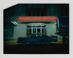 At the Station (DavidVonk) Tags: vintage instant film analog polaroid 360 land camera omaha union station nebraska neon sign 1958 buick special tail fins whitewalls whitewall tire tires chrome automobile car durham museum