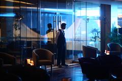Am I who I think I am ? (N A Y E E M) Tags: mahi mohyeddeen bartender night baikalbar radissonblu chittagong bangladesh light reflection neon availablelight indoors