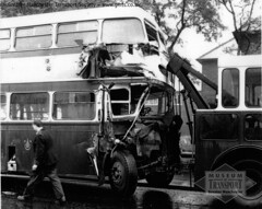 An Oldham Corporation bus after 'a bit of a bump' (Museum of Transport Greater Manchester archive) Tags: museum transport cheetham manchester wwwgmtscouk gmts bus buses museumoftransport gmtscollection greatermanchestertransportsociety boylestreet cheethamhill m88uw oldham corporation leyland titan pd2 roe aec matador tow breakdown lorry truck nbu507 407 accident crash collision mishap