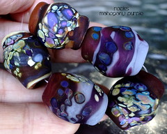 Rocks Mahogany Purple (Laura Blanck Openstudio) Tags: openstudio openstudiobeads glass murano handmade lampwork beads bead set jewelry whimsical funky odd frit organic abstract earthy asymmetric colorful multicolor rocks nuggets pebbles stones art fine arts artisan artist made usa published winner show festival big lavender lilac purple violet grape opaque matte etched frosted glow mahogany brown burgundy bordeaux wine eggplant ruby plum raku ocher blue speckles gray mauve