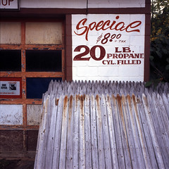 It Sure Is (george.bremer) Tags: 400x abandoned adirondacks closed e6 epson fence film fujiprovia400x garage mamiya mamiya6 newyork outofbusiness scan sign unicolor usa v750