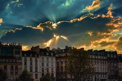 Sunset over the Left Bank (docoverachiever) Tags: sunburst france building sunset processed digitalart city cityscape clouds blue hss paris sunrays architecture skyline leftbank texture