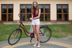 Going to the bike ride (piotr_szymanek) Tags: gosua young girl longhair straighthair windows grass smile shy firstsession gosia portrait liksajny blonde outdoor session