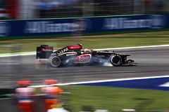 Romain Grosjean (Lotus) Locking Wheel Under Braking (craigmdennis) Tags: italy wheel lotus lock smoke f1 formulaone tyre monza romaingrosjean