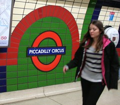 London Piccadily Circus tube (chrisw09) Tags: green london girl underground ceramic logo circus candid stripes transport tube piccadilly tiles commute oopsgirlisabitblurred