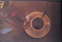 Un café con Kristina (Fer Svengali) Tags: camera summer film coffee café analog photography experimental verano filmcamera carrete filmphotography experimentalphotography 2013 usedabused