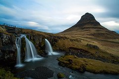 Kirkjufell view (Paolo.Riva.) Tags: longexposure trip travel vacation sky panorama sun white holiday verde green art love tourism nature water yellow clouds zeiss montagne canon wonderful lens landscape photography photo waterfall iceland nice exposure flickr nuvole day tour view outdoor natu