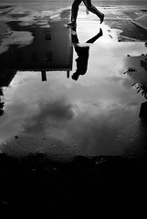A tribute to Mr. Bresson (Giulio Magnifico) Tags: life street city urban black reflection water rain composition contrast dark jump funny shadows candid citylife streetphotography intersection tribute bresson udine nikon1v1 1nikkor10mmf28