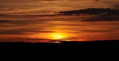 June sunset over Emley village, West Yorkshire (littlestschnauzer) Tags: above uk light sunset red summer sky cloud sun west nature weather silhouette june bronze rural evening countryside skies village yorkshire horizon elements setting descends wisps descending emley