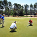 Alumnus Chris Hartwiger (right) checks putting green speed on the 2nd hole of Pinehurst No. 2 as fellow alumni John Jefferys and Kevin Robinson (blue shirts) look on during a break in US Women's Open action.