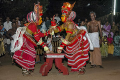 Theyyam Side to Side - 7 (Anoop Negi) Tags: kerala india theyyam winter kannur cannanore dance ritual religious trance induced red dress two dancers audience night shot color anoop negi ezee123 photo photography body paint painting bodypainting bali baali vellatam