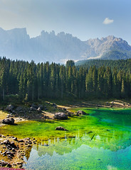 Lago Di Carezza (jimj0will) Tags: dolomites italy italia trento lake green blue iridescent water trees mountains landscape carezza rocks mist
