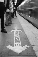 Stand Aside (Indofunk Satish) Tags: canonet film agfa apx100 blackwhite subway nyc manhattan train floor platform commute people indoors streetshot