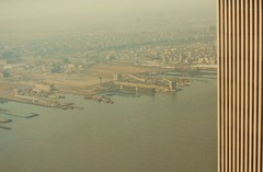 VIEW TO NJ FROM THE SOUTH TOWER IN 1985 (richie 59) Tags: newyorkstate newyork unitedstates nystate spring richie59 hudsonriver outside newjersey newyorkcity oldphotograph olddays oldpicture oldphoto 1985 april51985 april1985 photoscan manhattan batteryparkcity wordtradecenter wtc america 35mmfilm 35mm filmphotography photograph 1980s americancity uscity jerseycity thewaterfront waterfront docks river water bigcity largecity city urban smog skyscraper observationdeck view building