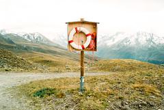 r_-- 1-63 (C H E M I C A L S) Tags: swiss alps floater color negative film kodak 200 analog mountains surrealism