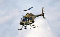 "Austrian Bell OH-58B ""Kiowa"" @ LOXZ (stecker.rene) Tags: oh58b kiowa oh58 bell helicopter rotorcraft pilot waving clouds sky 3coe austrianairforce austria airforce loxz zeltweg hinterstoisser austrian afb airbase aerodrome airpower airpower2016 airpower16 airshow aerialdisplay flyingdisplay military attack minigun canon eos7d tamron 150600mm bundesheer"