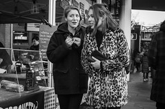 Portobello Road (jonron239) Tags: london women girls expression laugh smile winter coats fur leopardskin longhair pcoat rings market stall cafe ciabatta