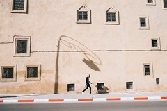 Fez (   ) Tags: street streetphotography shadow sun stranger smoker washout windows walker wall minimal minimalism minimalistic man road rays yellow urban outdoor photography old medina fez morocco poles architecture abstract alone documentary fujifilm journey xt1 contrast composition concrete cubes
