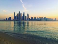 Beautiful sunset over the busy City Dubai. (charliesburns_3) Tags: sunset palm sea beach sun waves city dubai sky buildings uae fairmont hotel